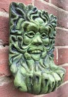 Green man plaque cupped hands bird feeder